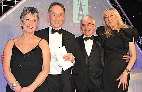 It was a busy night for Bill Mair, sales director of CJ Lang, above, second left, as he joined Scottish Wholesale Association executive director Kate Salmon,above left and presenter Cathy Macdonald, above right, on stage on three occasions to receive SWA Achievers awards. In the picture above they are joined by Peter Baird, field sales development manager, Kraft Foods UK for the presentation of the Champion of Champions Award.