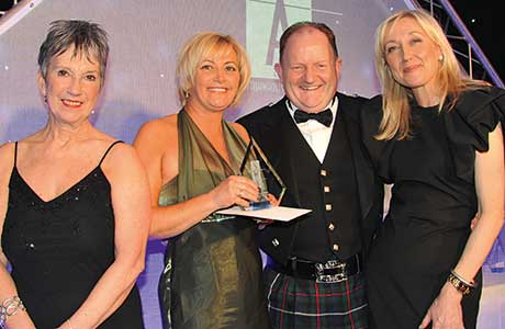 The Great Place to Work Award, won by JW Filshill and  sponsored by SHS Sales & Marketing. From left to right: Kate Salmon, executive director, SWA; Anne-Marie Johnstone, KeyStore area manager, JW Filshill; SHS Sales & Marketing's senior national account manager, Martin Dyer; and Cathy Macdonald.