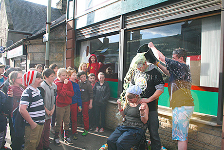 managing director Joanna Giacopazzi is well and truly cream pied as staff at the Milnathort store raise cash for Red Nose Day.