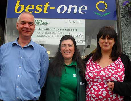 Bruce and Donna Morgan of Brownlies in Biggar with Angela McCormack, centre, from Macmillan Cancer Support.