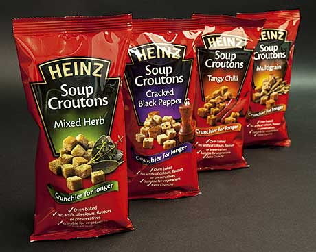 HEINZ has a new range of crunchy croutons designed to complement its soups. They'll be manufactured, marketed and sold under licence by Chaucer Foods, specialists in bread-related products.