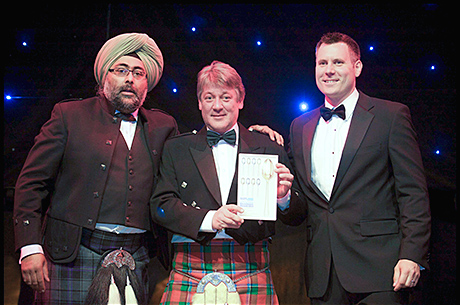 Norman Sinclair, centre, MD of Sinclair Breweries, picks up Orkney Dark Island Reserve's Scotland Food and Drink Excellence Award.