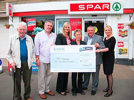 The winners! Left to right: Bill Watters and David Croll of the Ladybank Development Trust; Jill McEwan, area manager, Spar; Chrissie McLaren, Spar Ladybank; and Robert Wilson and Dionne Wilson, Kingsmill.