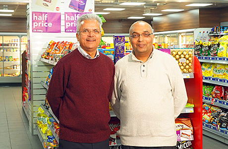Rakesh Sood, left, and Naresh Gajri, right, in their refurbed Cranhill Premier and Post Office. The major project, which included significant structural work and then a complete seven-day refit carried out by SAS Shopfitters, was a top-to-toe transformation of the 2,700 sq ft unit that sees high specification materials and equipment used throughout the shop.