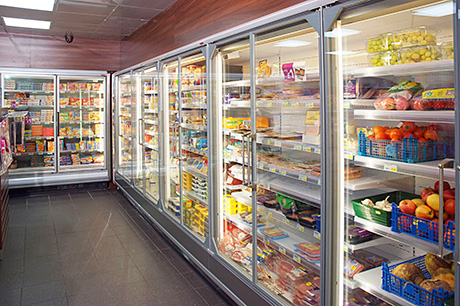 The U-shaped configuration of Arneg Brema freezers and Arneg Osaka chiller units, all of which are remote-controlled and feature hinged doors and deliver exceptional energy efficiency. Chillers used for non-perishable items, like the soft drinks chiller, above right, and the alcohol products chillers, switch off when the store is closed. With the new chillers and freezers and the Lumisheet LED lighting fitted, the store has seen energy costs drop substantially.