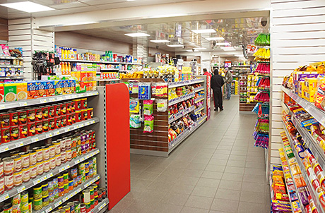 Looking from the chiller area back through Cranhill Premier Store. High shelving at the outer edges helps the store provide a wider range than before. Lower shelves in short aisles in the centre of the shop ensure all parts of the store are easily seen and provide extra space for aisle-end promotional displays.