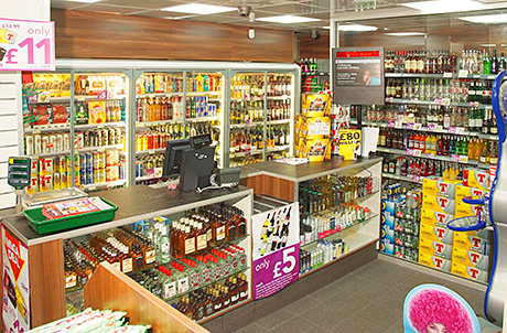 The well-designed off-sales section combines security and the ability to merchandise alcohol lines well.