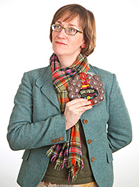 Jo Macsween, director and haggis ambassador for Macsween, with the firm's haggis as well as the vegetarian, canapé and microwaveable versions.