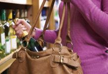 Woman shoplifting wine