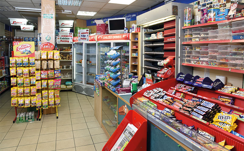 The community fridge and community cabinet are located close to the tills at RSA Your Local Shop. Service users can pick up food and check out via Rekz's ledger.