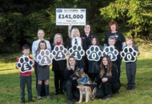 Lexi the dog and Scotmid staff, children, and the SSPCA.