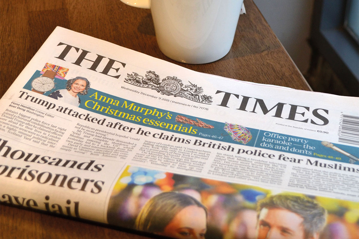 The Times newspaper on a cup of coffee