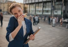 busy-woman-eating-sandwich