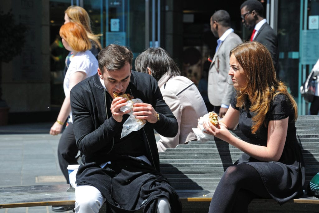 couple eating sandwiches
