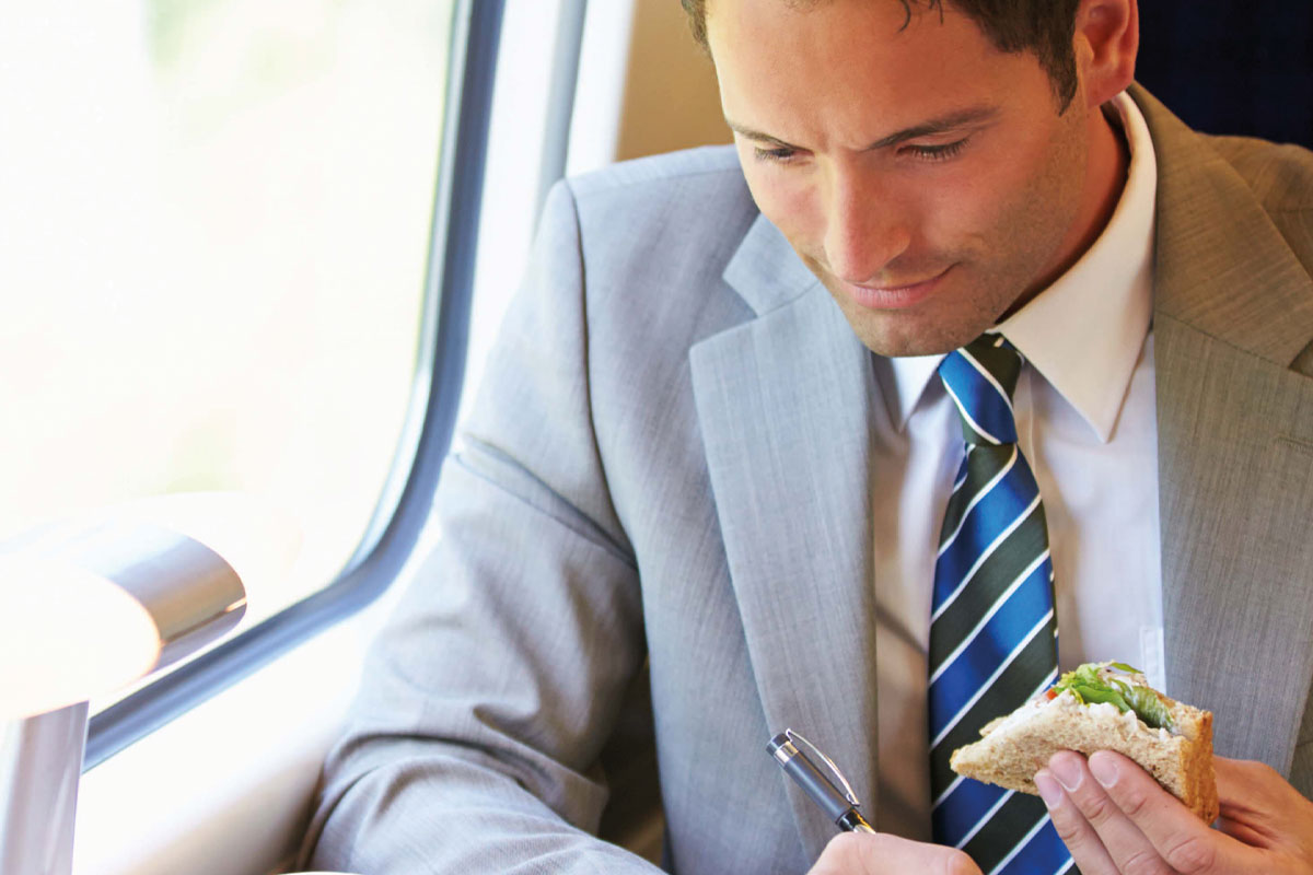 man eating on train