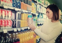 Woman looking at soft drinks
