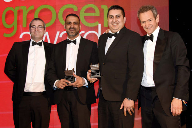 JTI's Stephen Donaghy and Alexander Armstrong present Sayiad and Imran with the 2019 Entrepreneur Award.