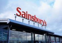 Orange Sainsbury Sign Over Supermarket