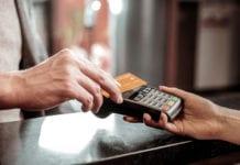 Hand using card machine