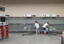 2 cust infront of empty shelves