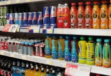 A display of soft drinks in a supermarket
