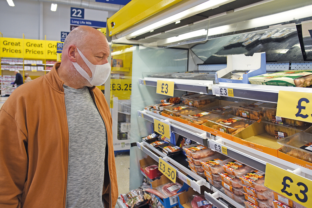 man with mask in shop