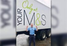 John Galls in front of an M&S lorry