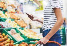 shopper in fruit aisle