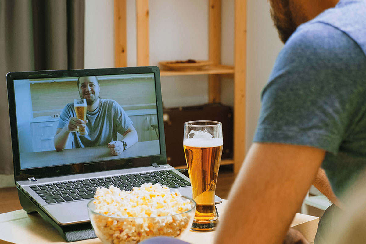 Man on video call drinking a pint