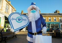 Blue santa with Scotland Loves Local sign