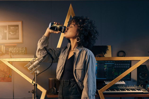 Rockstart relaunch promotion - woman drinking from can