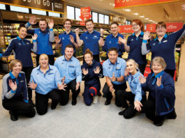 Aldi Staff smiling and posing in photo in store